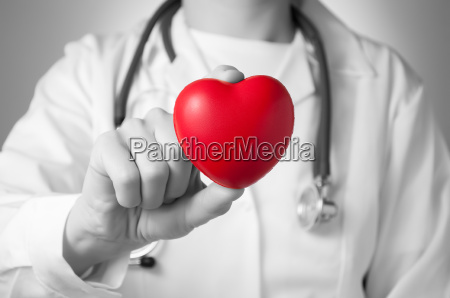 doctor holding a red heart