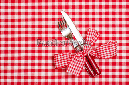 knife and fork with red plaid