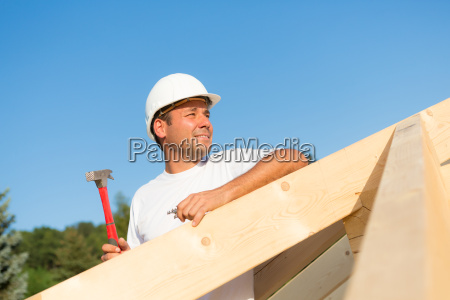 young construction worker on the roof