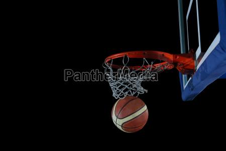 basketball ball and net on black