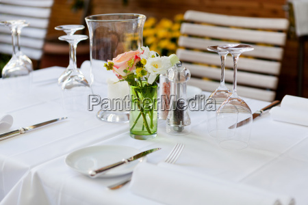 laid table in restaurant napkins glasses