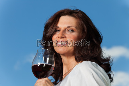 woman with red wine outdoors