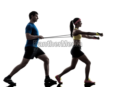 woman exercising fitness resistance rubber
