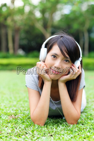 asian woman listen to song lying