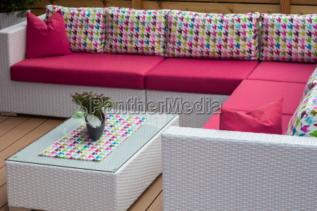 poly rattan couch on terrace