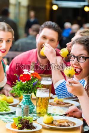 friends in bavaria drink beer in