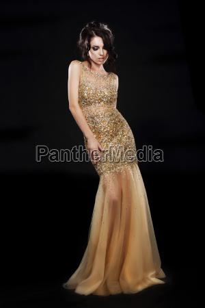 vogue beautiful fashion model in golden