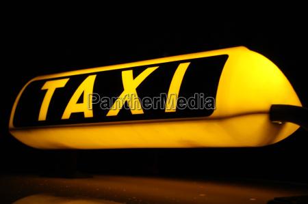 illuminated taxi sign at night
