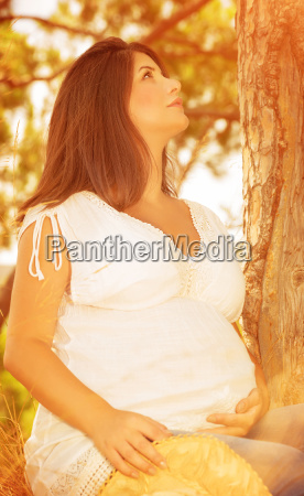 pregnant woman in autumnal forest