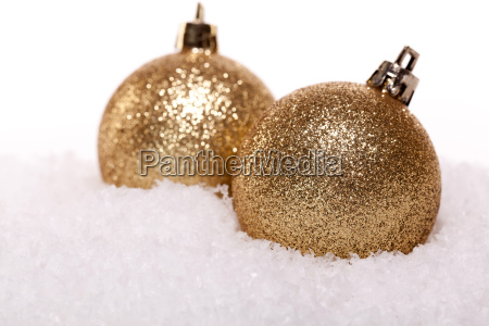 festive christmas decorations in gold shiny