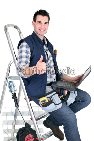 handyman with tools and a computer