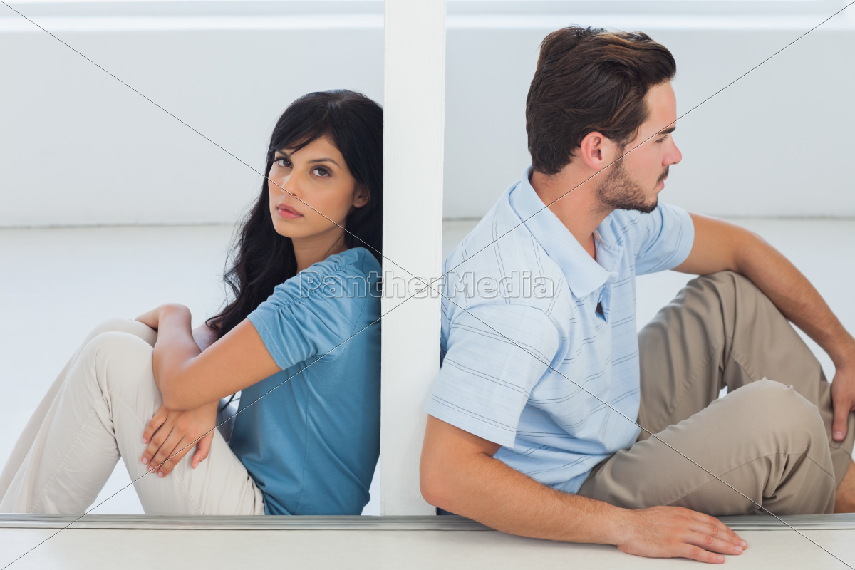 sitting, couple, are, separated, by, wall - 9915788