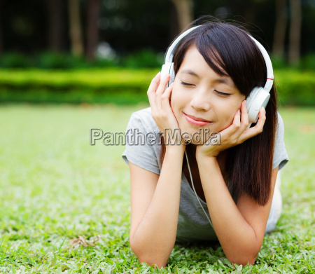 asian woman enjoy music