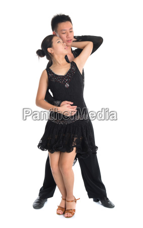 couple latin dancers dancing