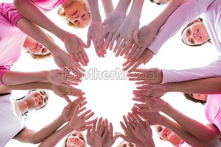 happy women in circle wearing pink