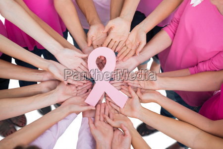 hands joined in circle holding breast