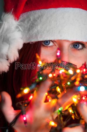 woman with christmas garland lights