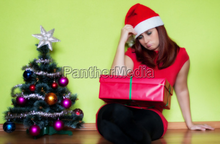 sad young woman alone in christmas