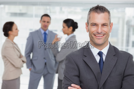 smiling manager posing with employees in