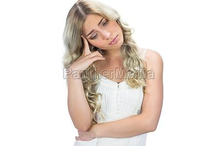 sad seductive model in white dress