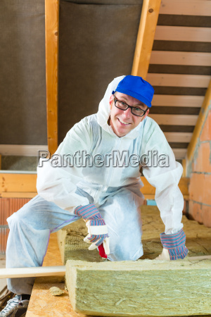 craftsmen cut insulation