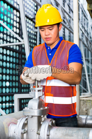 technicians or industrial workers working on