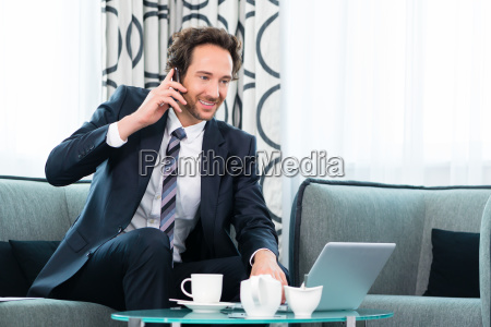 business person in the hotel phone