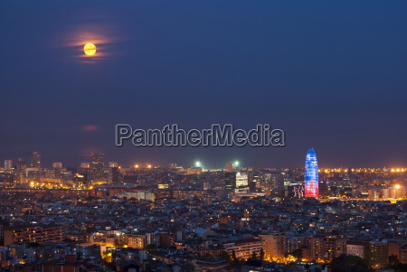 barcelona at night with full moon