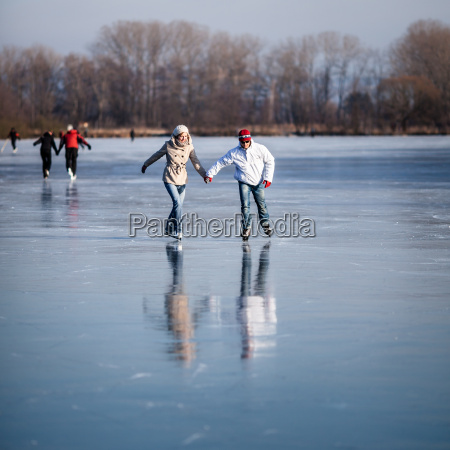 couple, ice, skating, outdoors, on, a - 10005182