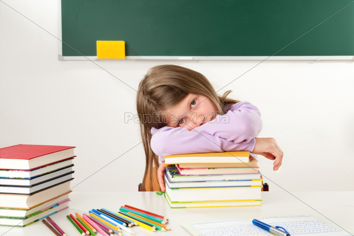 schoolgirl, leaning, on, a, pile, of - 10006586