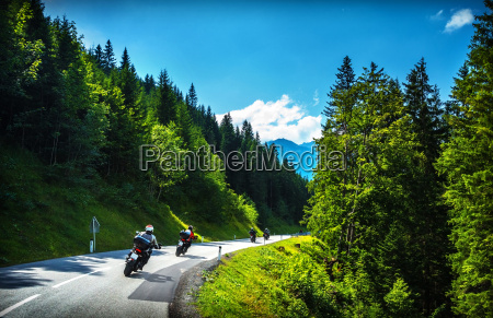 bikers in mountainous tour