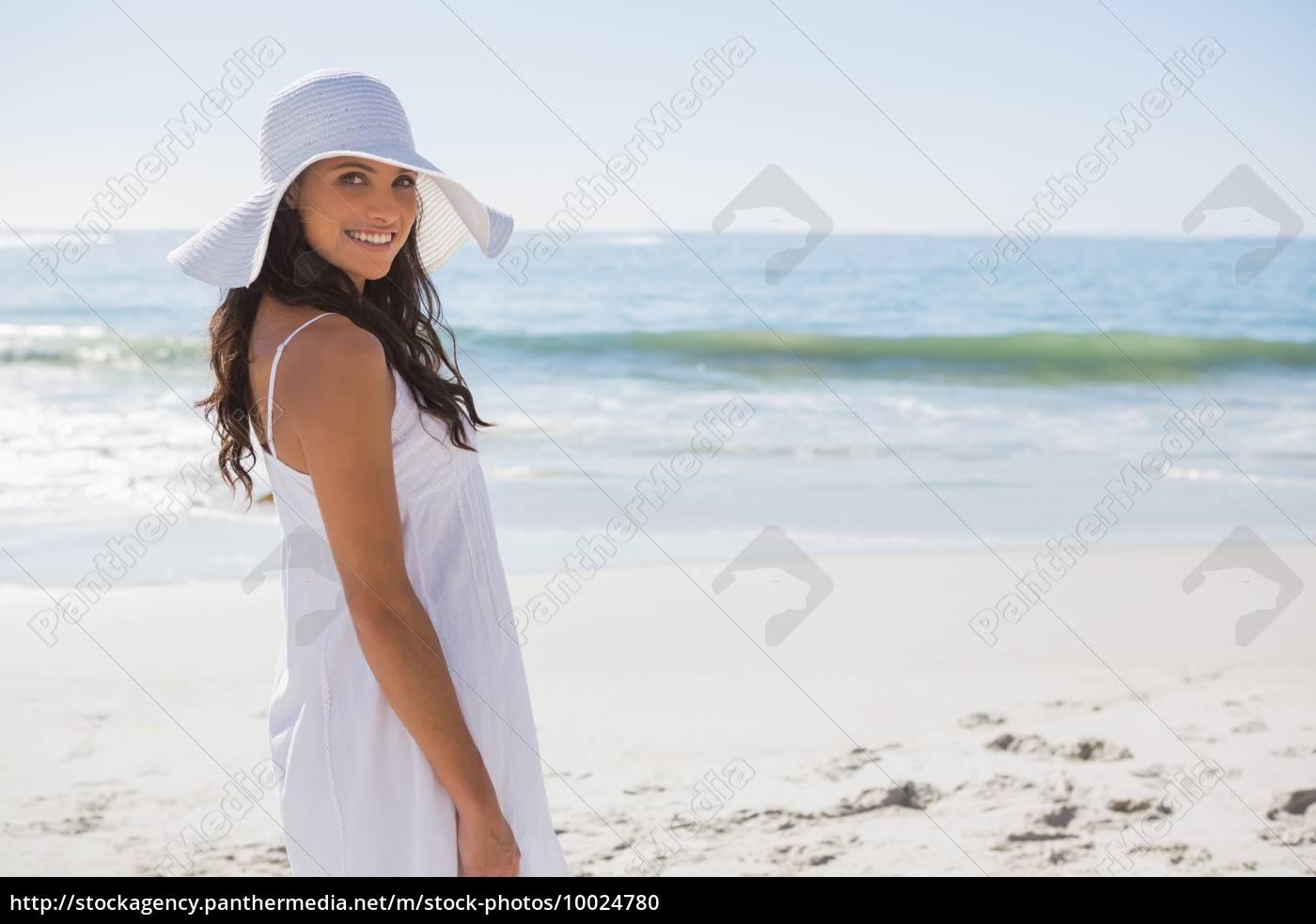 brunette, in, white, sunhat, looking, over - 10024780