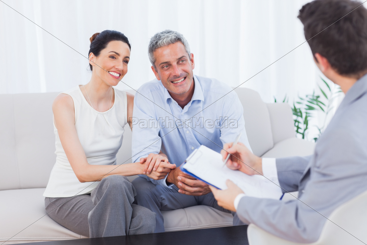 couple, listening, to, salesman, holding, contract - 10024662