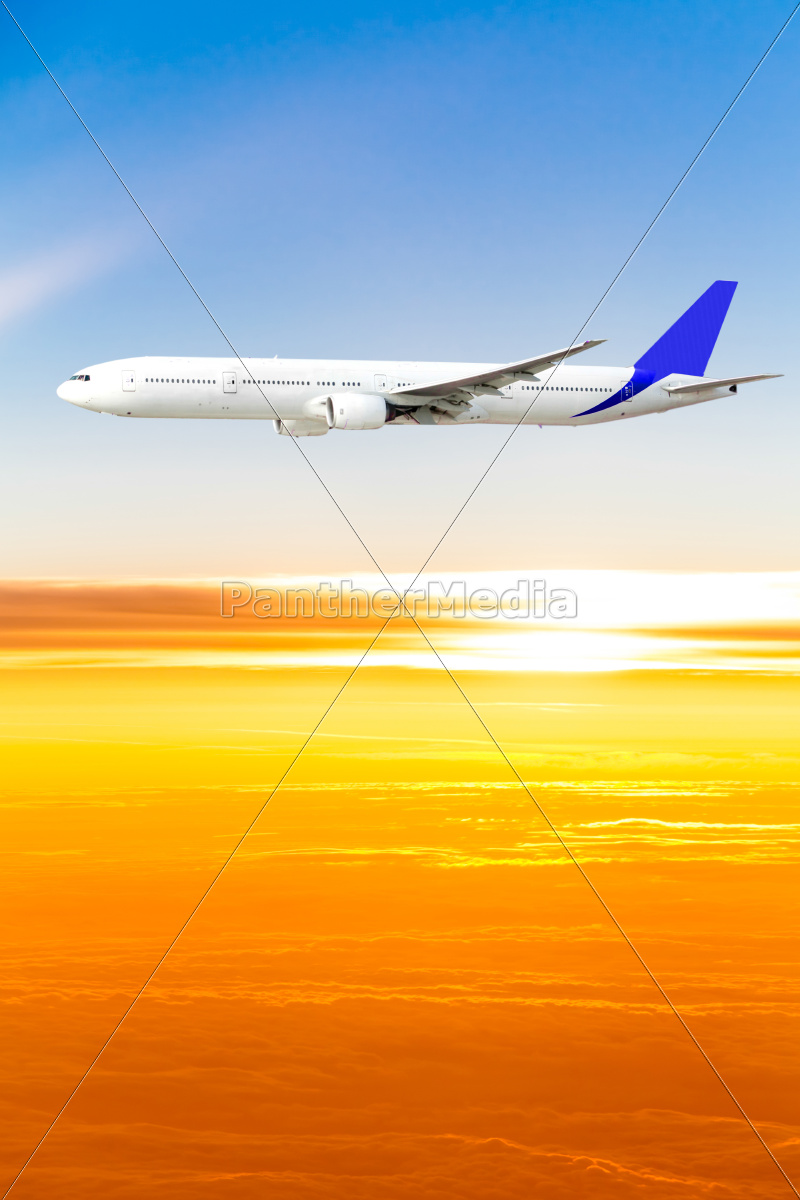 airplane, in, the, sky, at, sunset. - 10025474