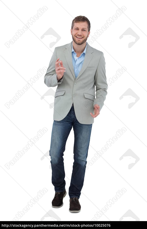 stylish, man, smiling, and, gesturing, at - 10025076