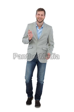 stylish, man, smiling, and, gesturing, at - 10025076