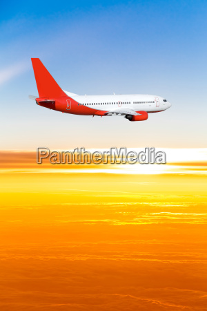 airplane, in, the, sky, at, sunset. - 10026348