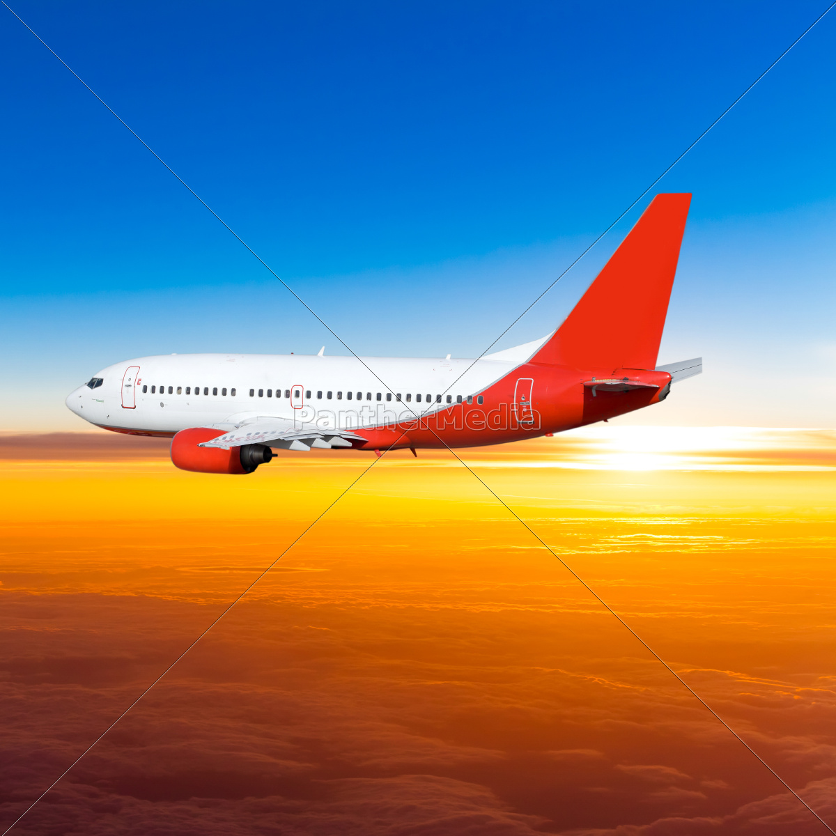 airplane, in, the, sky, at, sunset. - 10026394