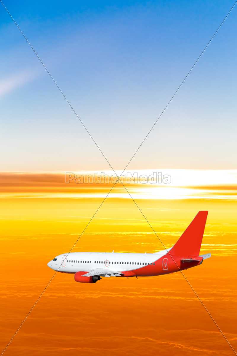 airplane, in, the, sky, at, sunset. - 10026456