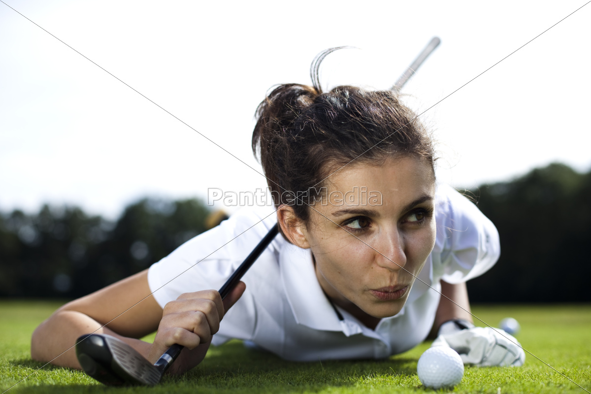 woman, playing, golf, on, field, - 10033594