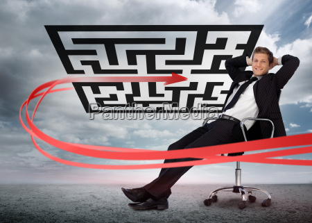 businessman sitting in front of red