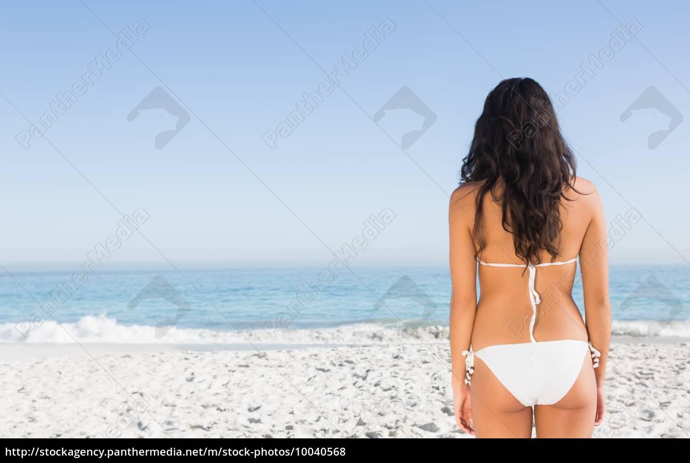 back, of, fit, brunette, posing, in - 10040568
