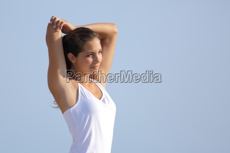 beautiful woman stretching with the sky