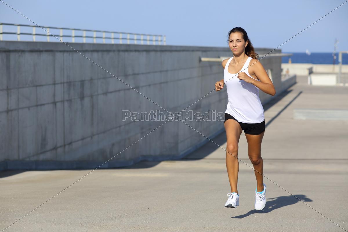 attractive, woman, running, on, the, asphalt - 10043426