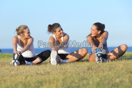 group, of, three, women, stretching, after - 10043682