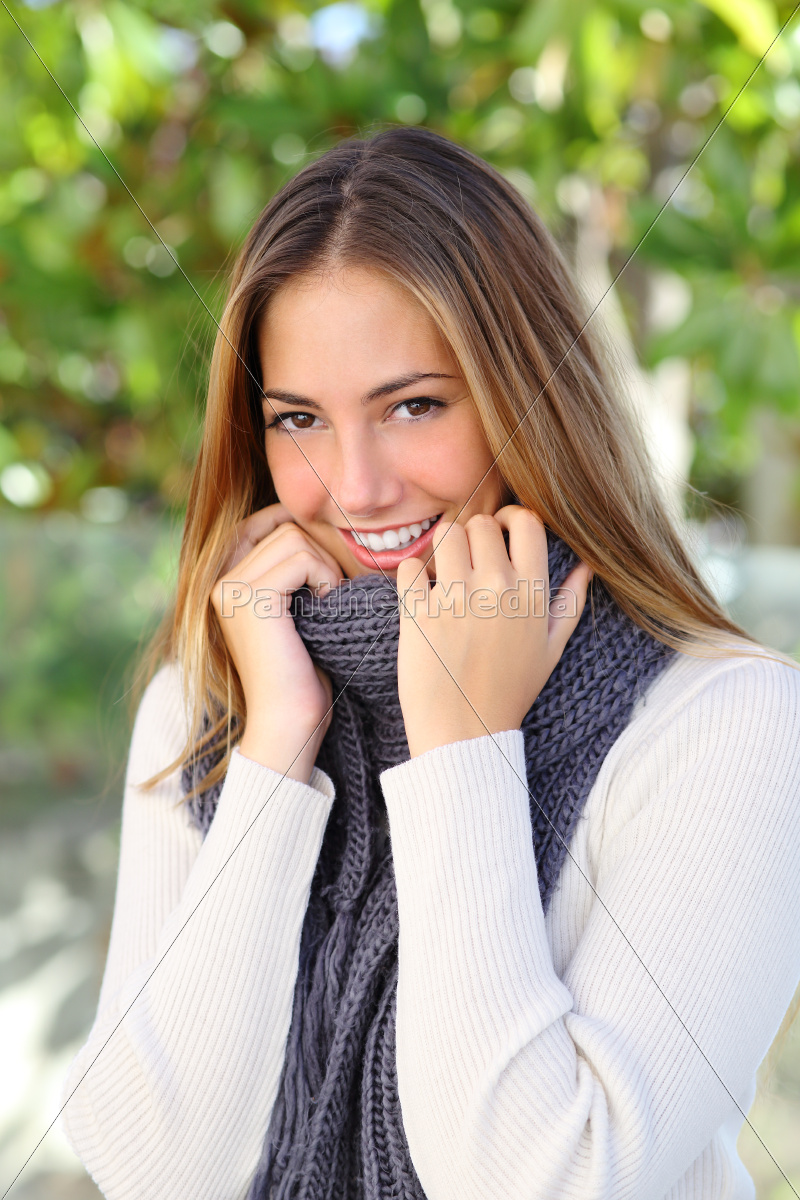 happy, woman, wrapping, with, a, sweater - 10043714