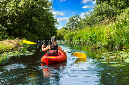 woman, with, paddle, in, canoe - 10067126