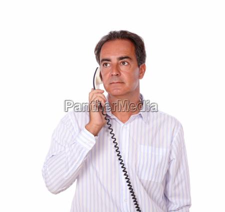 adult man doing a phone conversation
