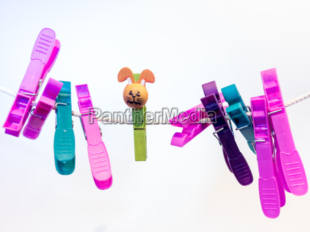 colorful character plastic pegs on a