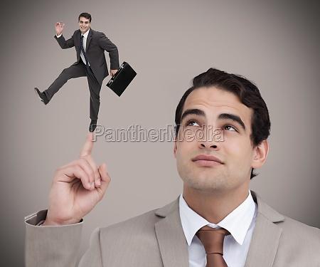 businessman, showing, shrunk, colleague, dancing, on - 10077708